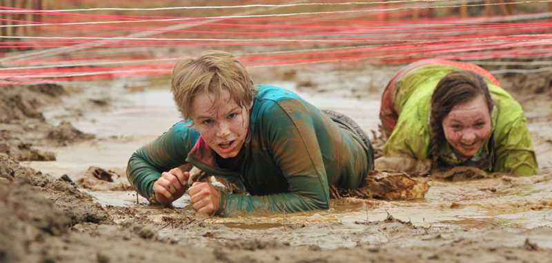 Competitors crawl through mud during the East Grand Adventure Race. (East Grand Adventure Race Photo)