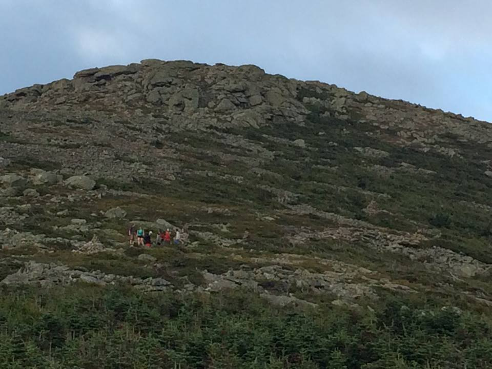 Three AMC hut crew and a mountain steward with the injured hiker and her family on the northwest slope of Lafayette, waiting for more help to arrive. (Pemigewasset Valley Search and Rescue Team/Facebook Photo)