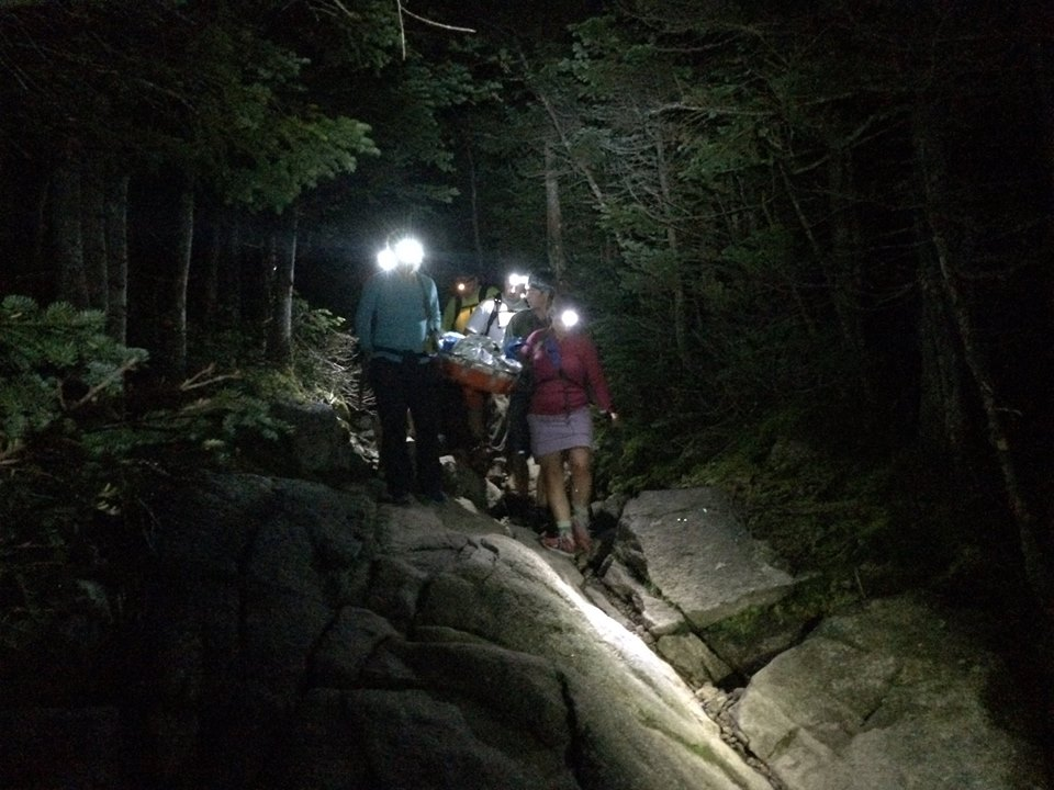 Rescue crews navigate steep, rocky terrain at night to carry an injured hiker down Lafayette. (Pemigewasset Valley Search and Rescue Team/Facebook Photo)