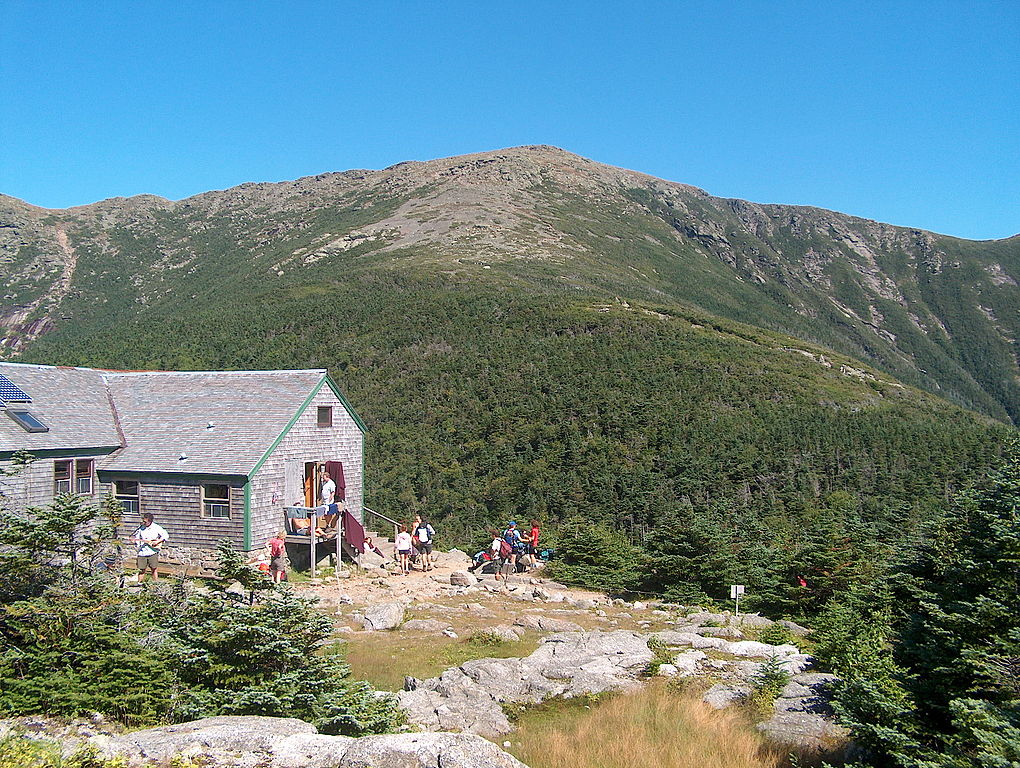 The Appalachian Mountain Club's Greenleaf Hut with Mount Lafayette in the background. (Wikimedia Photo)