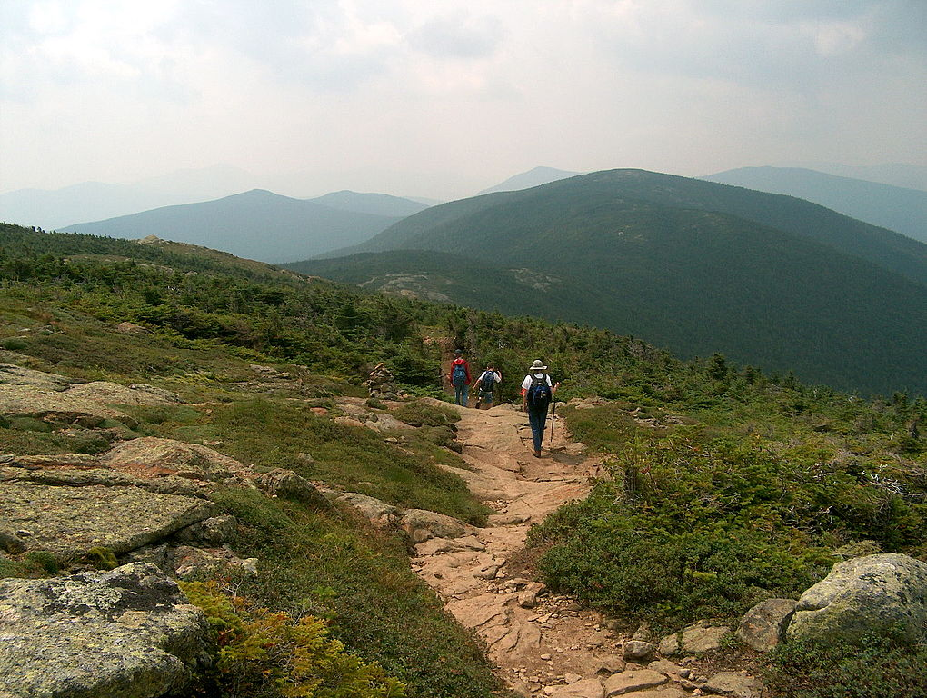 Hikers on the Appalachian Trail facing Mount Pierce in the White Mountains. (Wikimedia Photo)