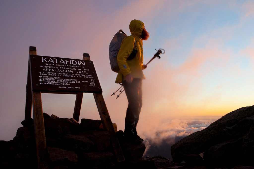 Hiker Jeffrey Stylos stands atop Katahdin at the end of his Appalachian Trail thru hike. (Jeffrey Stylos/Flickr Photo)