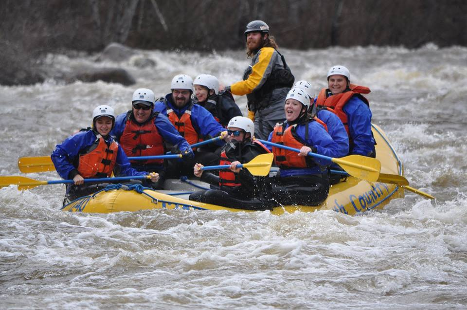 A group of rafters earlier this month aboard a North Country Rivers whitewater raft on the Dead River. (North Country Rivers/Facebook Photo)
