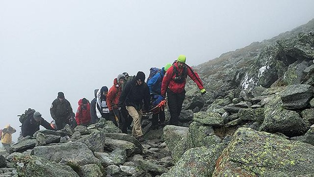Rescuers assist an injured hiker on Mount Washington. (NH Fish and Game Photos)