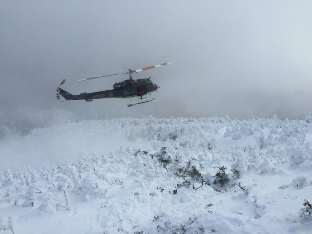 A helicopter rescues one of two hikers from New York's Algonquin Peak. (New York Department of Environmental Conservation Photo)