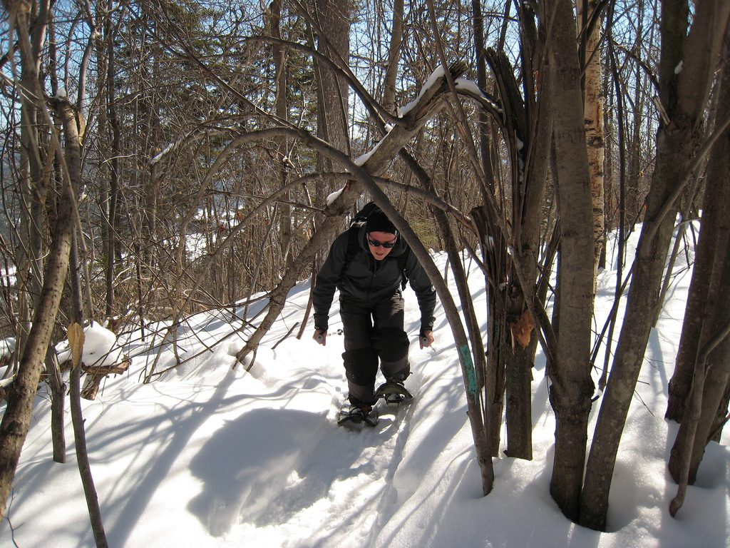 A man snowshoeing on Maine's Mt. Will. (ChrisDag/Flickr Photo)