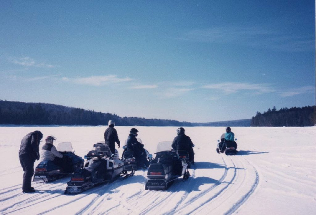 Snowmobilers on New Hampshire's Lake Winnipesaukee. (Winnipesaukee.com Photo)