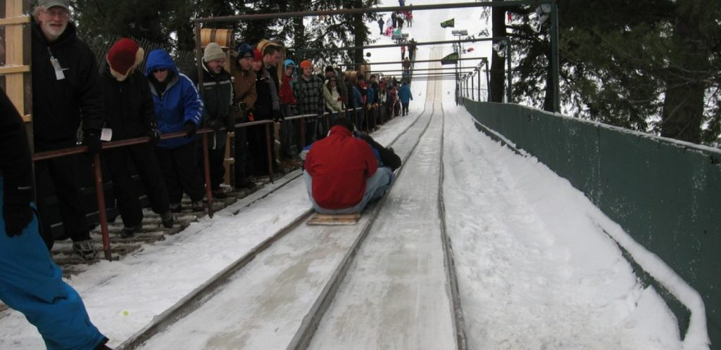 Riders on the old Lake Placid Toboggan Chute. (LakePlacid.com Photo)